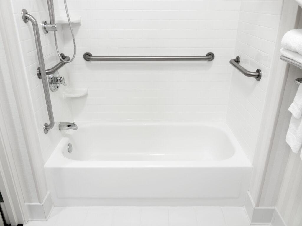 A bathtub with hand rails