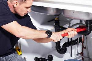 Biard and Crockett plumber fixing a sink in Tustin, CA