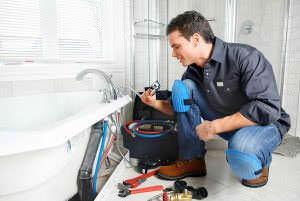 BCPSI Plumber repairing bathtub