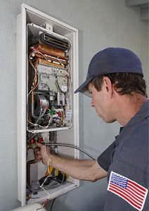 A technician installing a tankless water heater