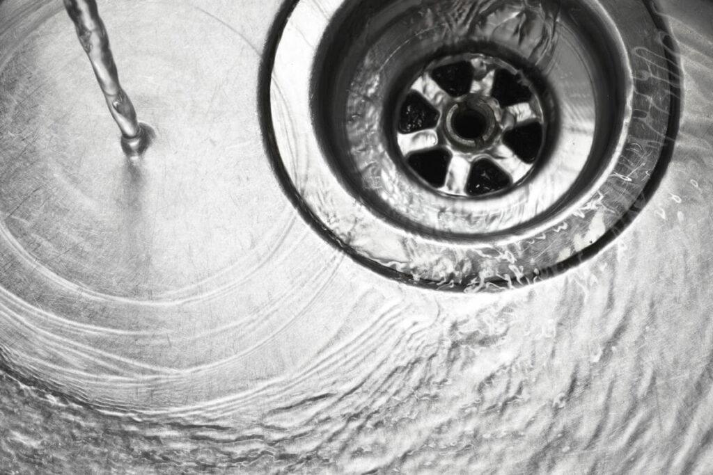 Water swirling down a drain